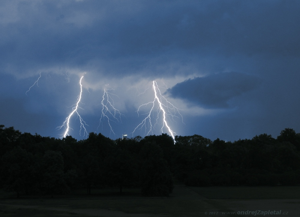 Fotografie Storm over the City, na fotce: clouds, night, nature, summer, electricity, trees, rain, autor: Ondřej Zapletal